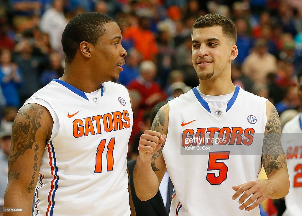 Scottie Wilbekin of the Florida Gators reacts with Lexx Edwards after their 7249 win over the Missouri Tigers during the quarterfinals of the SEC...
