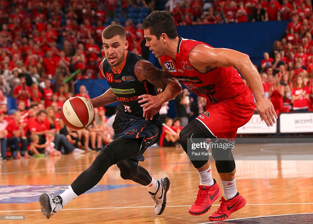 Scottie Wilbekin of the Taipans drives to the basket against Drake U'u of the Wildcats during game two of the NBL Finals series between the Perth...