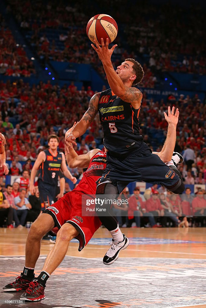 Scottie Wilbekin of the Taipans drives to the basket against Shawn Redhage of the Wildcats during the NBL round eight game between the Perth Wildcats...