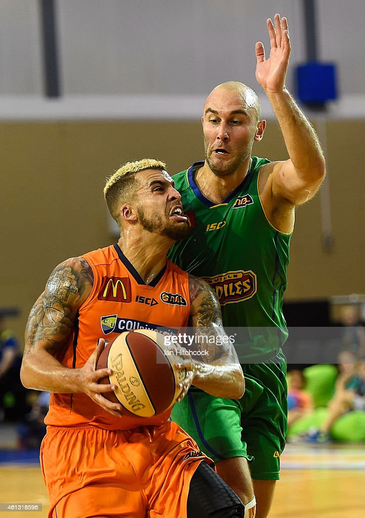 Scottie Wilbekin of the Taipans drives to the basket past Steven Markovic of the Crocodiles during the round 14 NBL match between the Townsville...