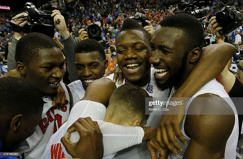 Scottie Wilbekin Will Yeguete Dorian FinneySmith and Patric Young of the Florida Gators celebrate their 61 to 60 win over the Kentucky Wildcats in...