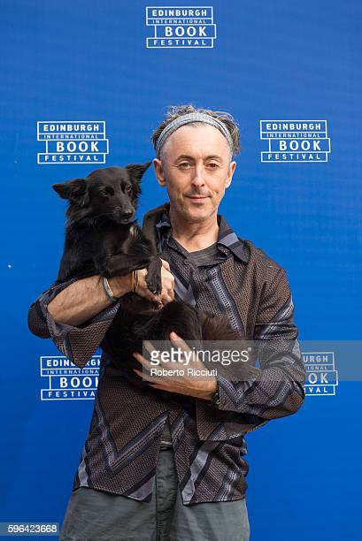 Scottish actor and author Alan Cumming attends a photocall together with his dog Lala at Edinburgh International Book Festival at Charlotte Square...