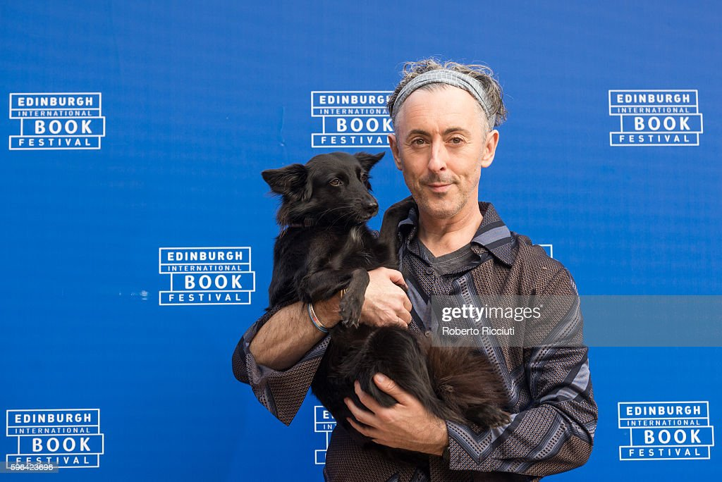 Scottish actor and author Alan Cumming attends a photocall together with his dog Lala at Edinburgh International Book Festival at Charlotte Square Gardens on August 27, 2016 in Edinburgh, Scotland.