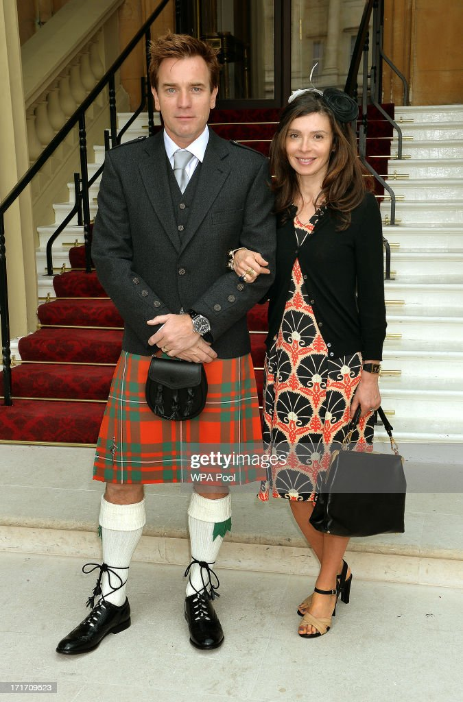 Scottish Actor Ewan McGregor with wife Eve Mavrakis arrive for the Investiture ceremony at Buckingham Palace on June 28, 2013 in London, England. Ewan McGregor will receive an OBE for services to Drama and Charity