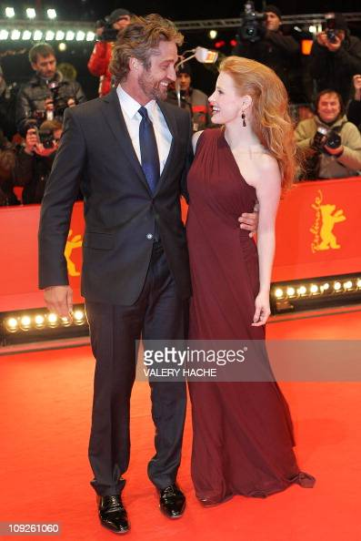 Scottish actor Gerard Butler and US actress Jessica Chastain arrive on the red carpet for the premiere of the movie 'Coriolanus' by British director...