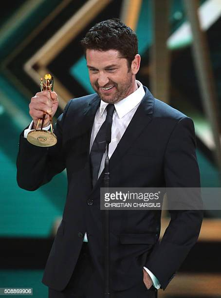 Scottish actor Gerard Butler receives the Golden Camera award for Best International actor in Hamburg northern Germany on February 6 2016 / AFP /...