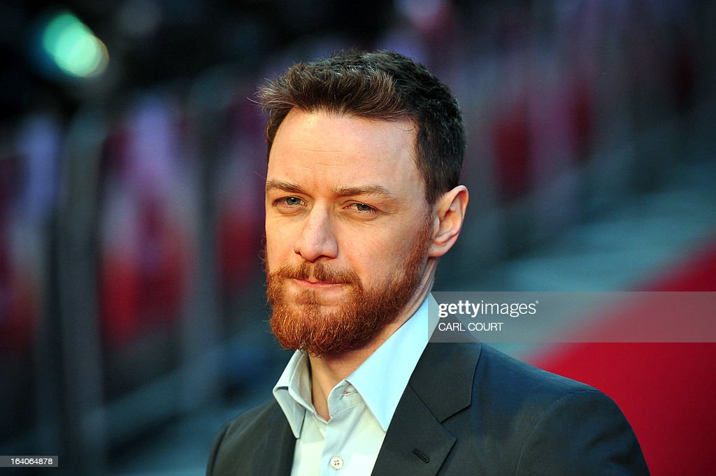 Scottish actor James McAvoy poses for pictures on the red carpet as he arrives to attend the world premiere of his latest film 'Trance' in central London on March 19, 2013.