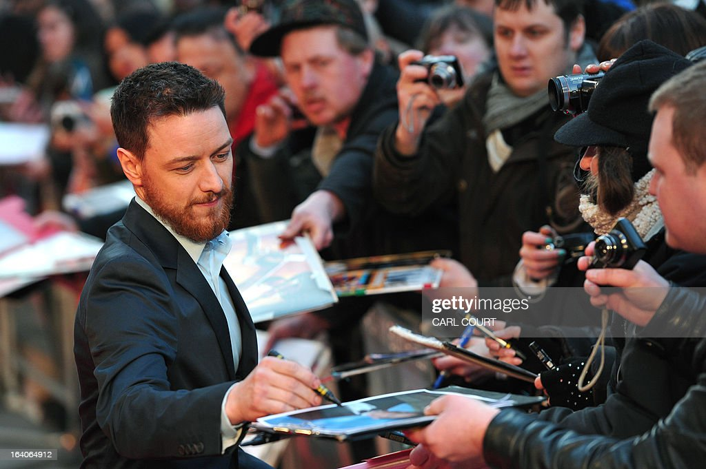 Scottish actor James McAvoy signs autographs for fans as he arrives to attend the world premiere of his latest film 'Trance' in central London on March 19, 2013.