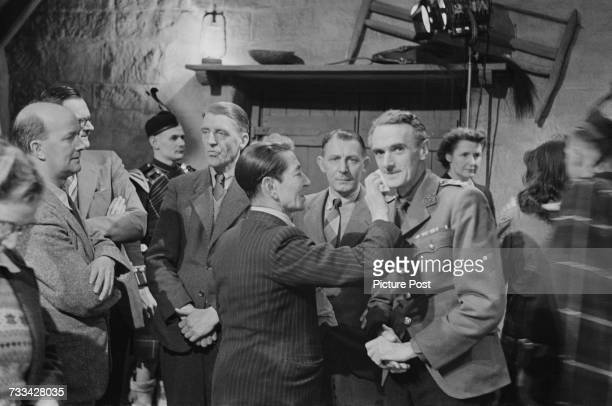 Scottish actor John Laurie has his makeup retouched on the set of 'I Know Where I'm Going' directed by Michael Powell and Emeric Pressburger 1945...
