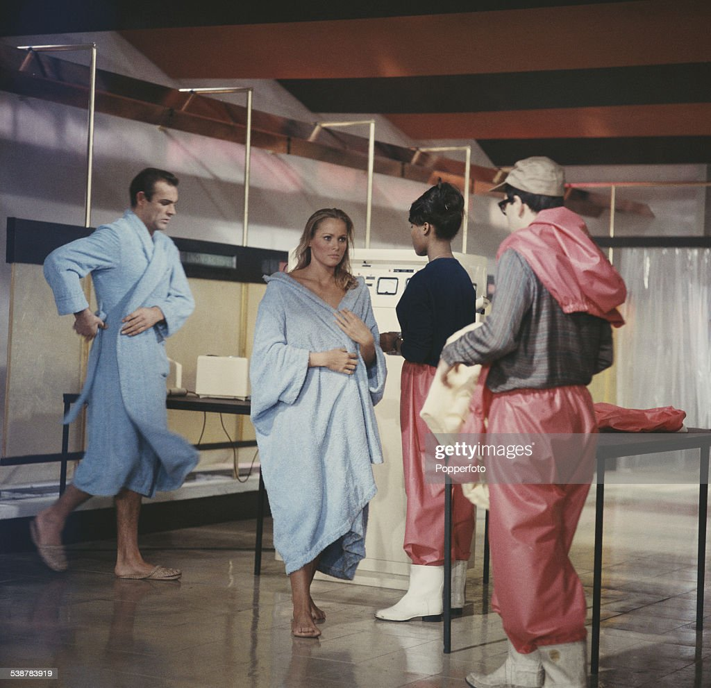 Scottish actor Sean Connery and Swiss born actress Ursula Andress pictured together in character as James Bond and Honey Ryder wearing blue robes during the shooting of a scene from the James Bond film 'Dr. No' at Pinewood Studios in England in 1962.