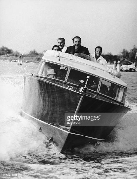 Scottish actor Sean Connery at the helm of a motorboat during the 28th Film Festival in Venice 1967