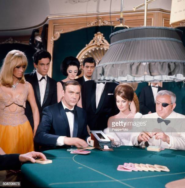Scottish actor Sean Connery performs in character as James Bond wiith Italian actor Adolfo Celi as eye patch wearing Emilio Largo in a casino scene...