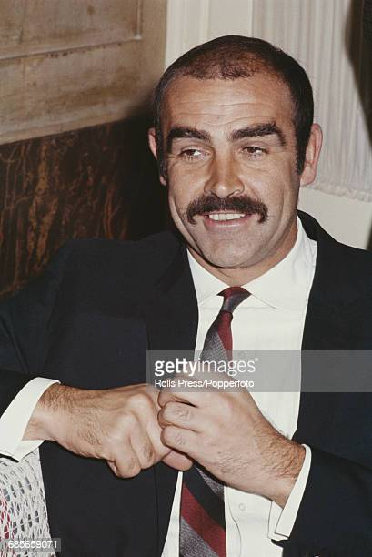 Scottish actor Sean Connery pictured sporting a moustache as he attends the Italian premiere of the film 'Shalako' in which he stars with Brigitte...