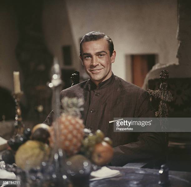 Scottish actor Sean Connery pictured wearing a Nehru jacket in character as James Bond in a scene from the James Bond film 'Dr No' at Pinewood...