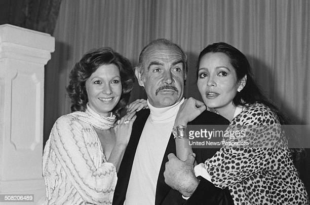 Scottish actor Sean Connery posed with Barbara Carrera and Pamela Salem during a press launch for the James Bond film Never Say Never Again at the...