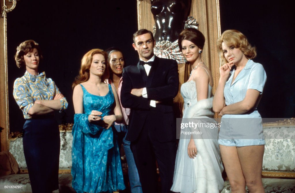 Scottish actor Sean Connery posed with (left to right) Lois Maxwell, Luciana Paluzzi, Martine Beswick, Claudine Auger and Molly Peters on the set of the James Bond film 'Thunderball' in 1965.