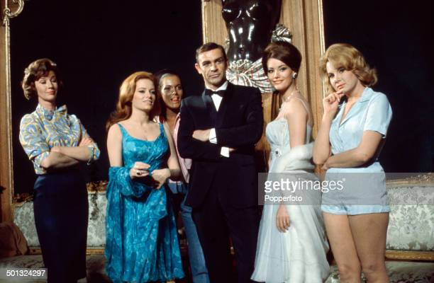 Scottish actor Sean Connery posed with Lois Maxwell Luciana Paluzzi Martine Beswick Claudine Auger and Molly Peters on the set of the James Bond film...