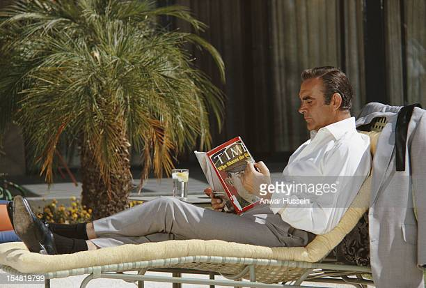 Scottish actor Sean Connery relaxes on the set of the James Bond film 'Diamonds Are Forever' USA May 1971 He is reading the 12th April 1971 edition...