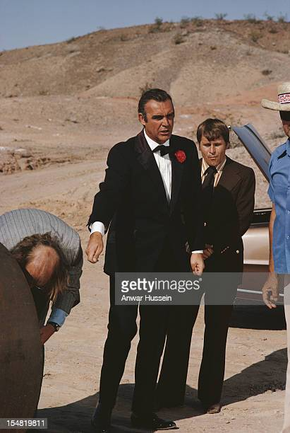 Scottish actor Sean Connery with actors Putter Smith and Bruce Glover on the set of the James Bond film 'Diamonds Are Forever' USA May 1971