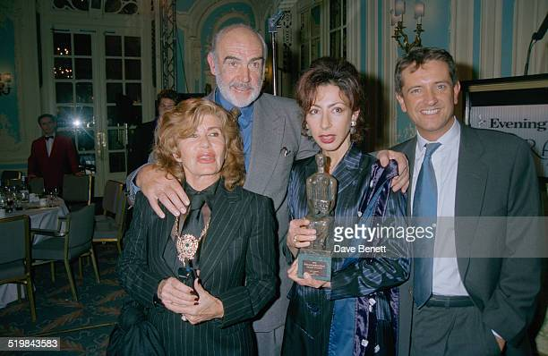 Scottish actor Sean Connery with his wife Micheline Roquebrune and French writer Yasmina Reza at the Evening Standard Theatre Awards held at the...