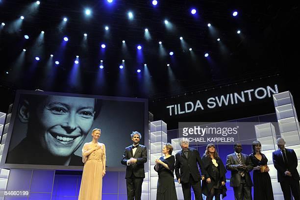 Scottish actress and jury president Tilda Swinton poses with jury members German theatre director Christoph Schlingensief US food activist star chef...