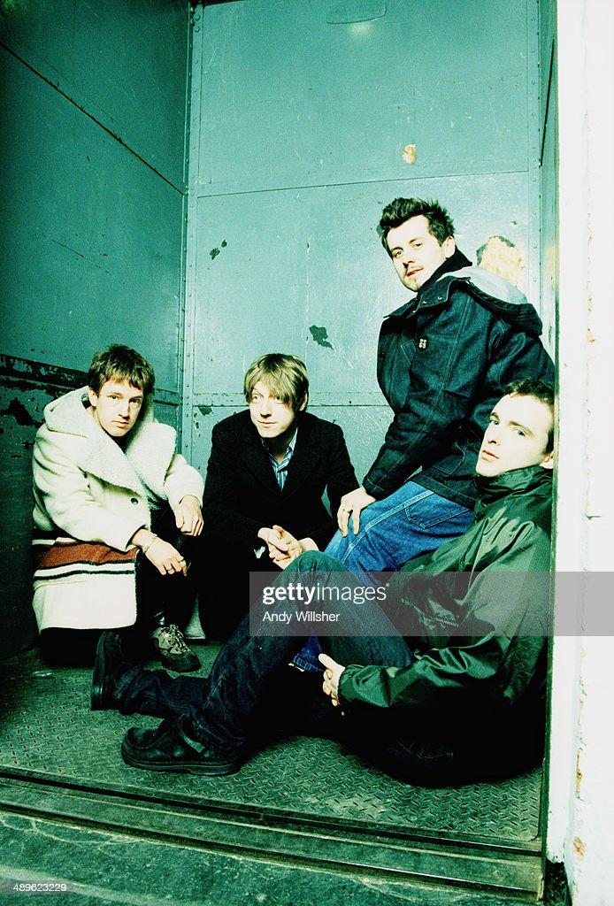 Scottish alternative rock group Travis circa 2001 Left to right guitarist Andy Dunlop bassist Dougie Payne drummer Neil Primrose and singer Fran Healy