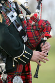 Wonderful rich colours of tartan worn by the Scottish Bag Piper