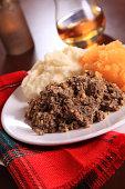 Scottish Haggis Table Setting For A Burns Night Dinner With A Royal Stuart Tartan Napkin, To Celebrate Scotland's National Poet, Robert Burns