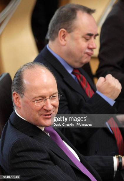 Scottish Cabinet Secretary for Finance and Sustainable Growth John Swinney and Scottish First Minister Alex Salmond during First Ministers Questions...