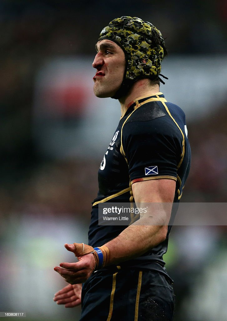 Scottish Captain, <a gi-track='captionPersonalityLinkClicked' href=/galleries/search?phrase=Kelly+Brown+-+Rugby+Player&family=editorial&specificpeople=211000 ng-click='$event.stopPropagation()'>Kelly Brown</a> encourages his team during the RBS Six Nations match between France and Scotland at Stade de France on March 16, 2013 in Paris, France.