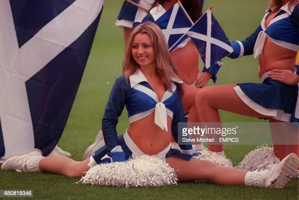 A Scottish cheerleader does the splits as the Scottish team are presented to the media