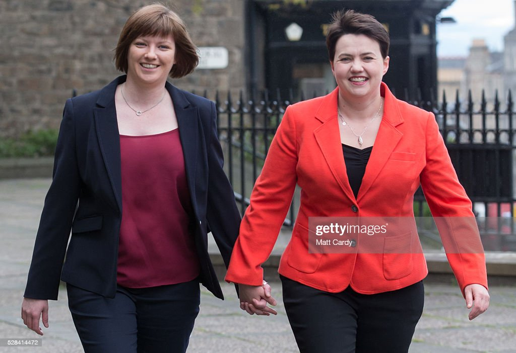 Scottish Conservative Leader Ruth Davidson (R) and her partner Jen Wilson arrive at St Mary's Parish Church to vote in the Scottish Parliament elections on May 5, 2016 in Edinburgh, Scotland. Today, dubbed 'Super Thursday', sees the British public vote in countrywide elections to choose members for the Scottish Parliament, the Welsh Assembly, the Northern Ireland Assembly, Local Councils, a new London Mayor and Police and Crime Commissioners. There are around 45 million registered voters in the UK and polling stations open from 7am until 10pm.