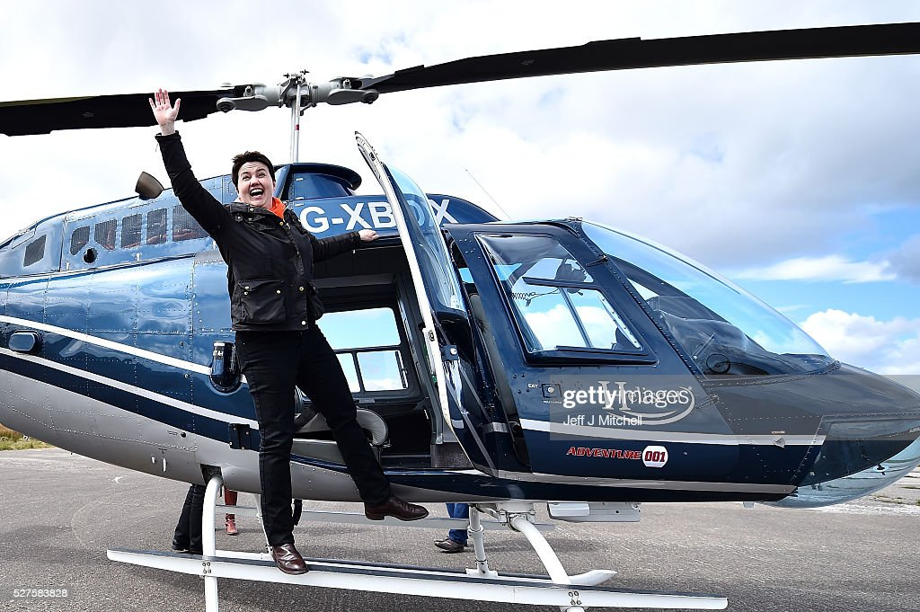 Scottish Conservative leader <a gi-track='captionPersonalityLinkClicked' href=/galleries/search?phrase=Ruth+Davidson&family=editorial&specificpeople=8602778 ng-click='$event.stopPropagation()'>Ruth Davidson</a> boards a helicopter bound for Keith during a coast-to-coast tour as campaigning continues for the Holyrood election on May 3, 2016 in Peterhead, United Kingdom. As campaigning for the Holyrood election enters its last forty eight hours, recent polls suggest the Conservatives are virtually neck-and-neck with Labour in the race to be the main opposition party in Scotland.