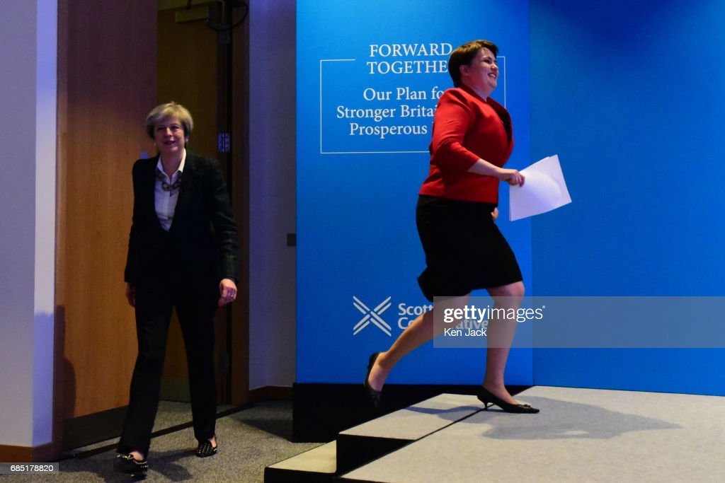 Scottish Conservative leader Ruth Davidson (R) bounds on to the stage as she and Prime Minister Theresa May (L) arrive for the launch of the Scottish Conservative Party general election manifesto, on May 19, 2017 in Edinburgh, Scotland. A UK general election is to be held on Thursday June 8, 2017.