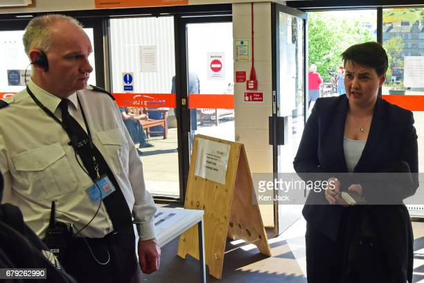 Scottish Conservative leader Ruth Davidson fumbles for ID as she is challenged by a security guard on arrival at the local election count in...