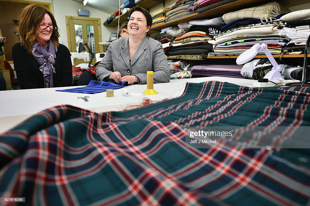Scottish Conservative leader Ruth Davidson has a go at kilt sewing as she speaks to staff at Keith Kilt and Textile Centre during a coast-to-coast tour by helicopter as campaigning continues for the Holyrood election on May 3, 2016 in Keith, United Kingdom. As campaigning for the Holyrood election enters its last forty eight hours, recent polls suggest the Conservatives are virtually neck-and-neck with Labour in the race to be the main opposition party in Scotland.