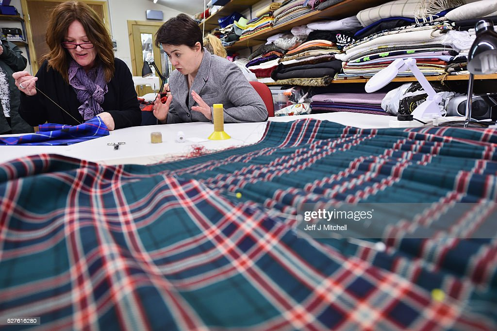 Scottish Conservative leader Ruth Davidson has a go at sewing a kilt as she speaks to staff at Keith Kilt and Textile Centre during a coast-to-coast tour by helicopter as campaigning continues for the Holyrood election on May 3, 2016 in Keith, United Kingdom. As campaigning for the Holyrood election enters its last forty eight hours, recent polls suggest the Conservatives are virtually neck-and-neck with Labour in the race to be the main opposition party in Scotland.