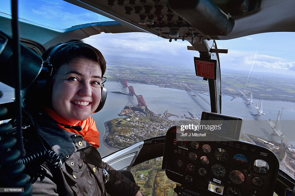 Scottish Conservative leader <a gi-track='captionPersonalityLinkClicked' href=/galleries/search?phrase=Ruth+Davidson&family=editorial&specificpeople=8602778 ng-click='$event.stopPropagation()'>Ruth Davidson</a> looks out the window at the Forth Road Bridge and Queensferry Crossing on board a helicopter during a coast-to-coast tour as campaigning continues for the Holyrood election on May 3, 2016 in North Queensferry, United Kingdom. As campaigning for the Holyrood election enters its last forty eight hours, recent polls suggest the Conservatives are virtually neck-and-neck with Labour in the race to be the main opposition party in Scotland.