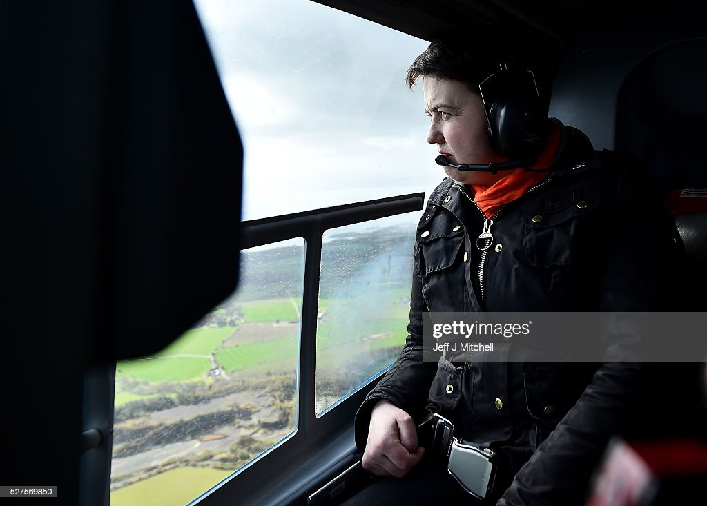 Scottish Conservative leader <a gi-track='captionPersonalityLinkClicked' href=/galleries/search?phrase=Ruth+Davidson&family=editorial&specificpeople=8602778 ng-click='$event.stopPropagation()'>Ruth Davidson</a> looks out the window on board a helicopter during a coast-to-coast tour as campaigning continues for the Holyrood election on May 3, 2016 in Unspecified, United Kingdom. As campaigning for the Holyrood election enters its last forty eight hours, recent polls suggest the Conservatives are virtually neck-and-neck with Labour in the race to be the main opposition party in Scotland.