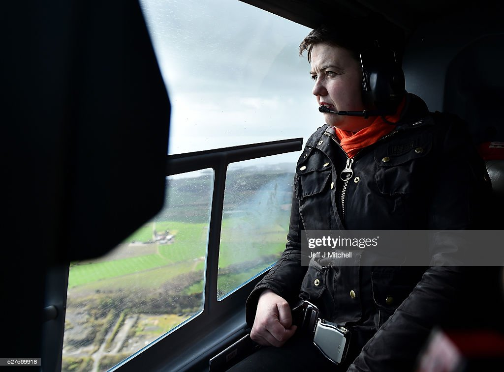 Scottish Conservative leader <a gi-track='captionPersonalityLinkClicked' href=/galleries/search?phrase=Ruth+Davidson&family=editorial&specificpeople=8602778 ng-click='$event.stopPropagation()'>Ruth Davidson</a> looks out the window on board a helicopter during a coast-to-coast tour as campaigning continues for the Holyrood election on May 3, 2016 in Oban, United Kingdom. As campaigning for the Holyrood election enters its last forty eight hours, recent polls suggest the Conservatives are virtually neck-and-neck with Labour in the race to be the main opposition party in Scotland.