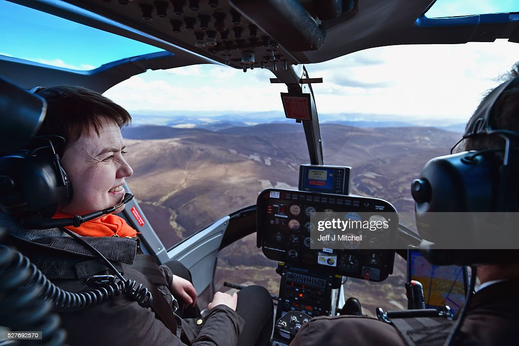 Scottish Conservative leader <a gi-track='captionPersonalityLinkClicked' href=/galleries/search?phrase=Ruth+Davidson&family=editorial&specificpeople=8602778 ng-click='$event.stopPropagation()'>Ruth Davidson</a> looks out the window on board a helicopter during a coast-to-coast tour as campaigning continues for the Holyrood election on May 3, 2016 in Keith, United Kingdom. As campaigning for the Holyrood election enters its last forty eight hours, recent polls suggest the Conservatives are virtually neck-and-neck with Labour in the race to be the main opposition party in Scotland.