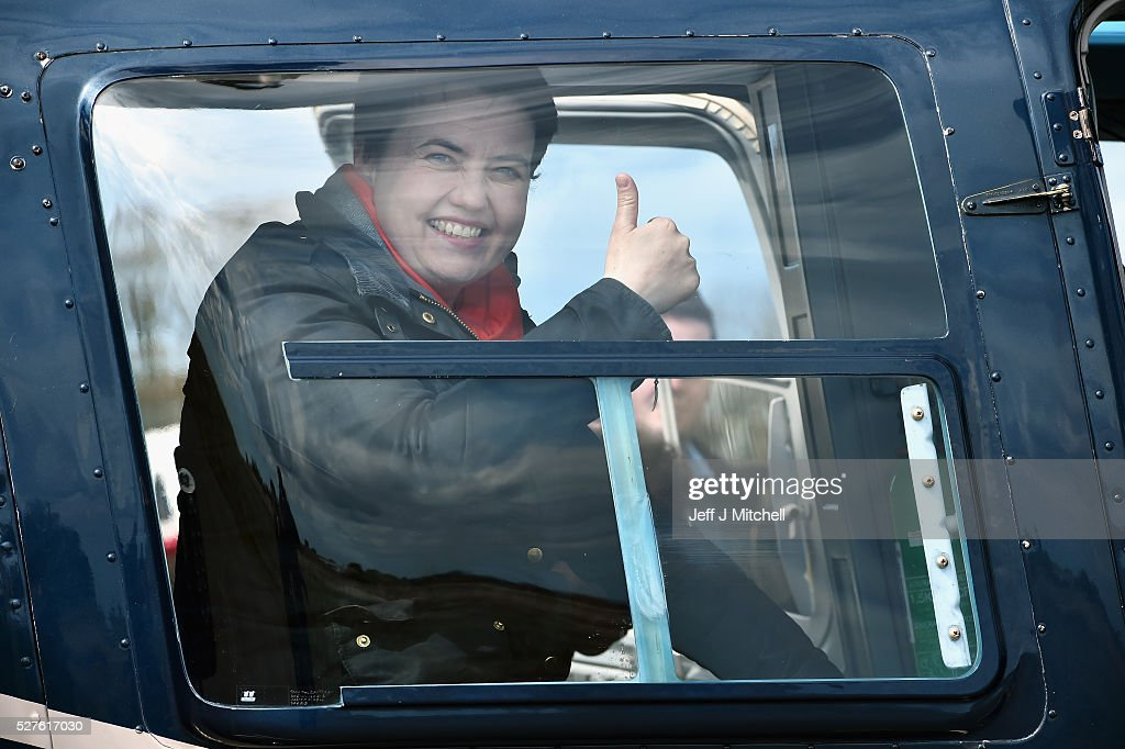 Scottish Conservative leader <a gi-track='captionPersonalityLinkClicked' href=/galleries/search?phrase=Ruth+Davidson&family=editorial&specificpeople=8602778 ng-click='$event.stopPropagation()'>Ruth Davidson</a> reacts while on board a helicopter during a coast-to-coast tour as campaigning continues for the Holyrood election on May 3, 2016 in Keith, United Kingdom. As campaigning for the Holyrood election enters its last forty eight hours, recent polls suggest the Conservatives are virtually neck-and-neck with Labour in the race to be the main opposition party in Scotland.