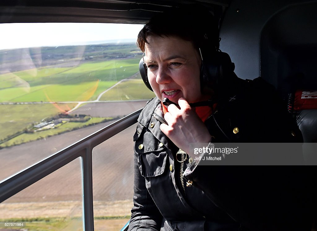 Scottish Conservative leader <a gi-track='captionPersonalityLinkClicked' href=/galleries/search?phrase=Ruth+Davidson&family=editorial&specificpeople=8602778 ng-click='$event.stopPropagation()'>Ruth Davidson</a> speaks on the radio on board a helicopter during a coast-to-coast tour as campaigning continues for the Holyrood election on May 3, 2016 in Scotland, United Kingdom. As campaigning for the Holyrood election enters its last forty eight hours, recent polls suggest the Conservatives are virtually neck-and-neck with Labour in the race to be the main opposition party in Scotland.
