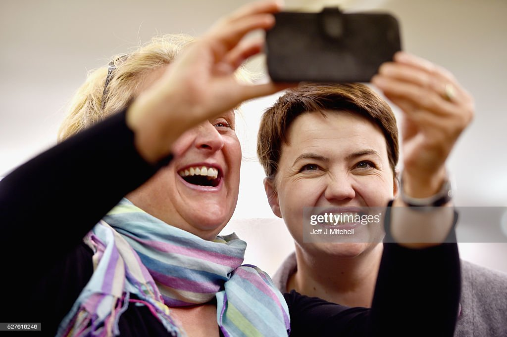 Scottish Conservative leader Ruth Davidson takes a selfie with staff at Keith Kilt and Textile Centre during a coast-to-coast tour by helicopter as campaigning continues for the Holyrood election on May 3, 2016 in Keith, United Kingdom. As campaigning for the Holyrood election enters its last forty eight hours, recent polls suggest the Conservatives are virtually neck-and-neck with Labour in the race to be the main opposition party in Scotland.