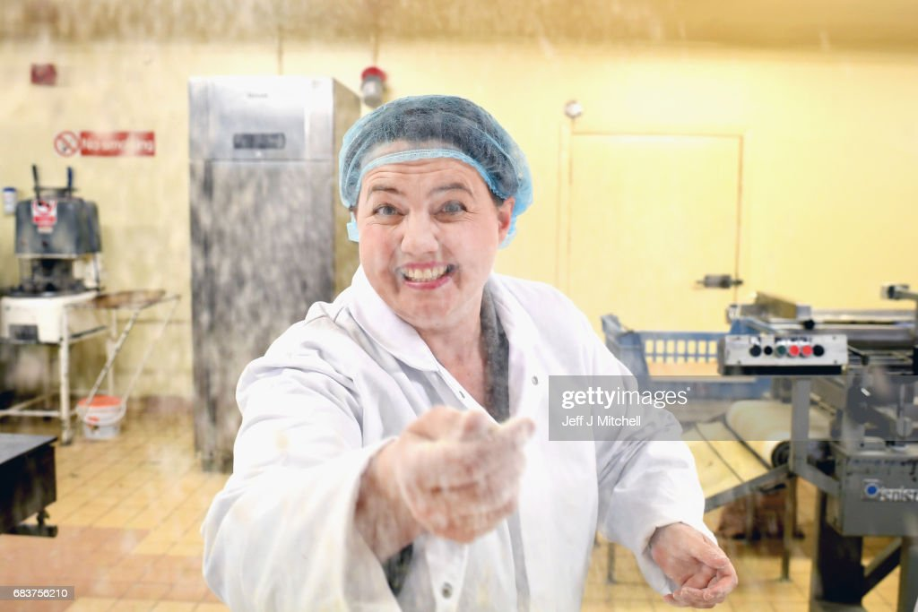 Scottish Conservative leader Ruth Davidson throws flour as she poses for a photograph during campaigning with local candidate Allister Jack at Express Bakery on May 17, 2017 in Dumfries, Scotland. Britain goes to the polls on June 8 to elect a new parliament in a general election.