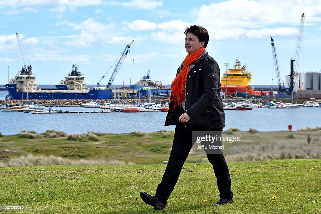 Scottish Conservative leader Ruth Davidson walks by Peterhead port during a coast-to-coast tour by helicopter as campaigning continues for the Holyrood election on May 3, 2016 in Peterhead, United Kingdom. As campaigning for the Holyrood election enters its last forty eight hours, recent polls suggest the Conservatives are virtually neck-and-neck with Labour in the race to be the main opposition party in Scotland.