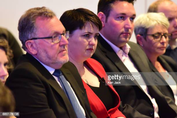 Scottish Conservative Party leader Ruth Davidson C Scottish Secretary David Mundell and Miles Briggs MSP listen to Prime Minister Theresa May...
