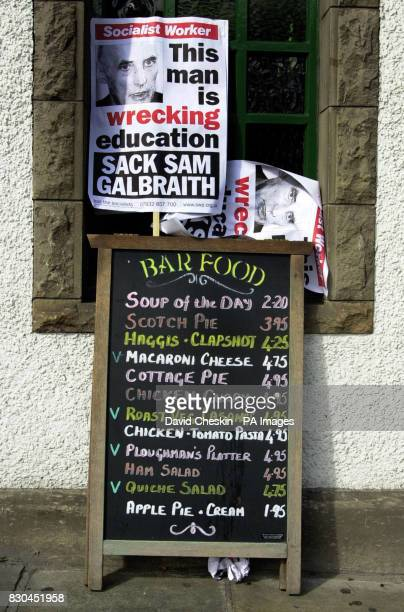 Scottish Education Minister Sam Galbraith was met by banners on the menu board of a pub next door to the Scottish Parliament Edinburgh as he arrived...