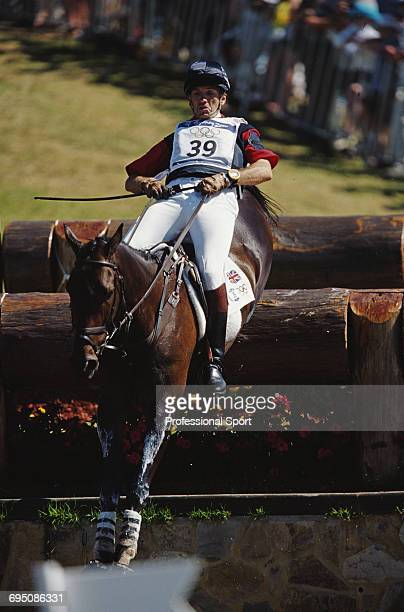 Scottish equestrian Ian Stark competes on Jaybee at the water jump for the Great Britain team to finish in second place to win the silver medal in...