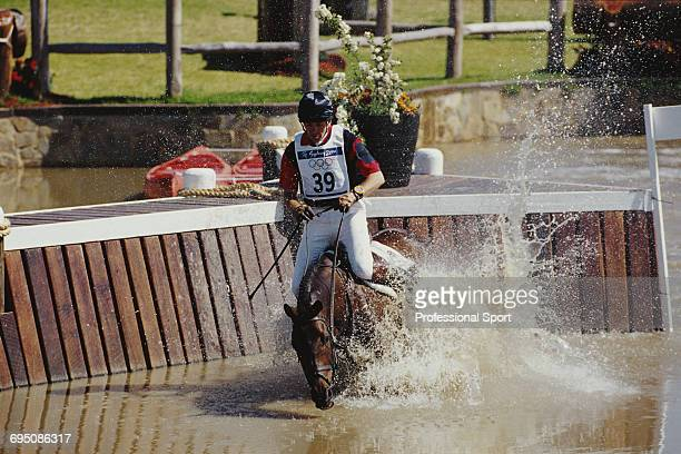 Scottish equestrian Ian Stark competing on Jaybee for the Great Britain team falls at the water jump prior to the GB team finishing in second place...